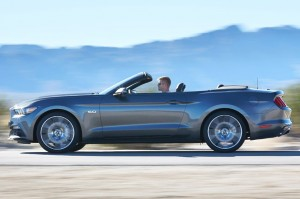 2015-Ford-Mustang-GT-convertible-side-motion-view
